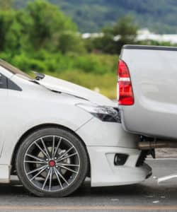 accident caused when two cars collided at a red light