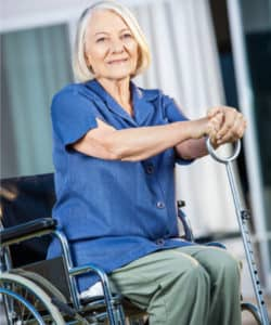 nursing home resident sitting in chair and smiling