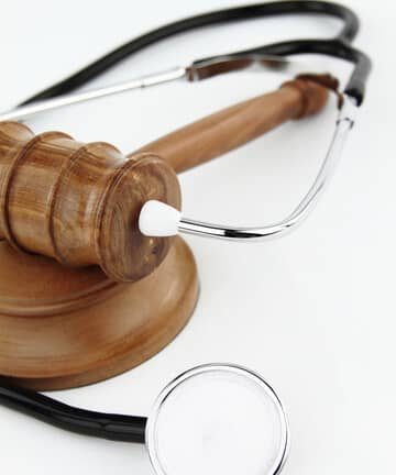 image of a gavel with stethoscope wrapped around it