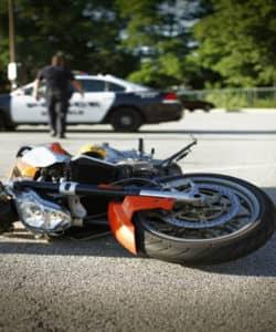 motorcycle laying on the floor after crash