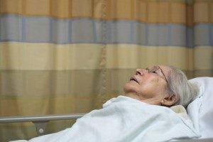 nursing home patient in bed