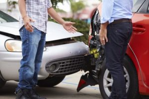 two drivers discussing about a car accident outside